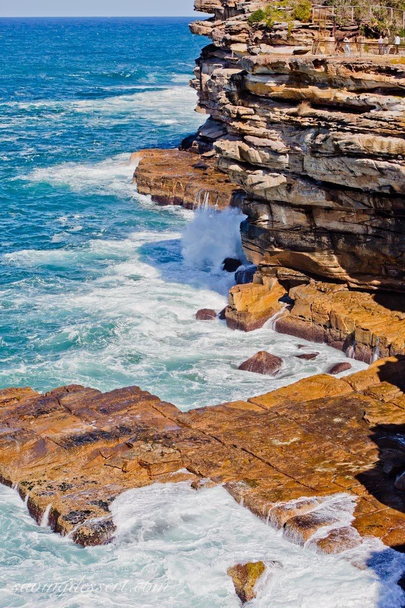 Crashing waves on the cliffs by the walk around Watsons Bay near Sydney Australia