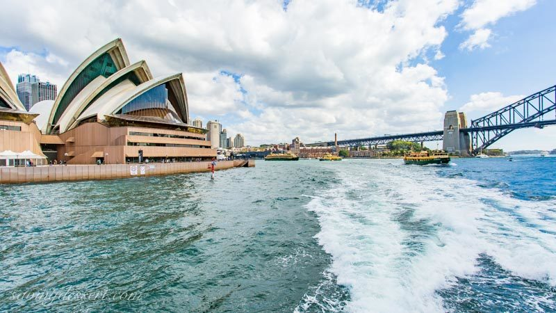 A look back from the ferry toward downtown, the Sydney Opera House and the Sydney Harbour Bridge.