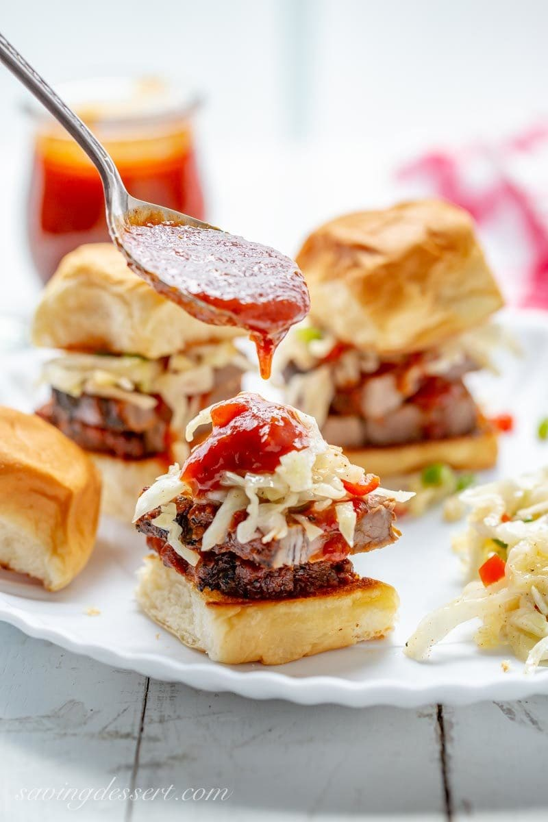 Toasted rolls with sliced beef brisket, Cole slaw and BBQ sauce - sliders!