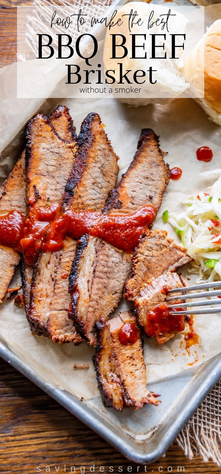 Sliced BBQ Beef brisket on a try served with rolls and cole slaw