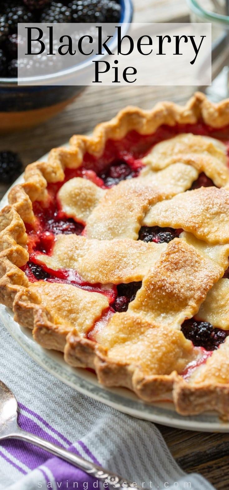 A homemade blackberry pie with purple juices poking through the lattice crust