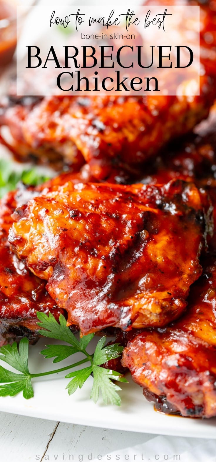 A platter of barbecued chicken pieces slathered in BBQ sauce