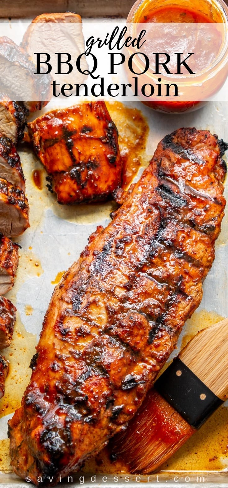 A whole grilled pork tenderloin with homemade BBQ sauce