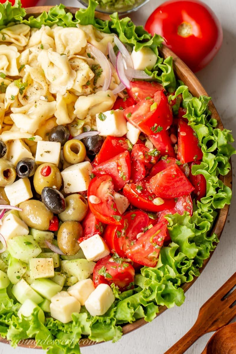 A big bowl of marinated tomato and tortellini salad
