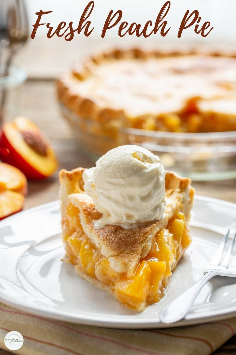 A slice of fresh peach pie with a scoop of vanilla ice cream on top