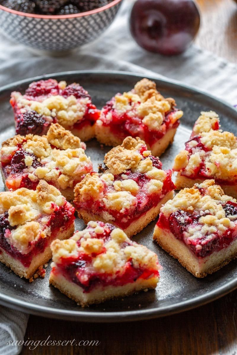 Plum blackberry bars cut into squares with a shortbread crumble dough on top