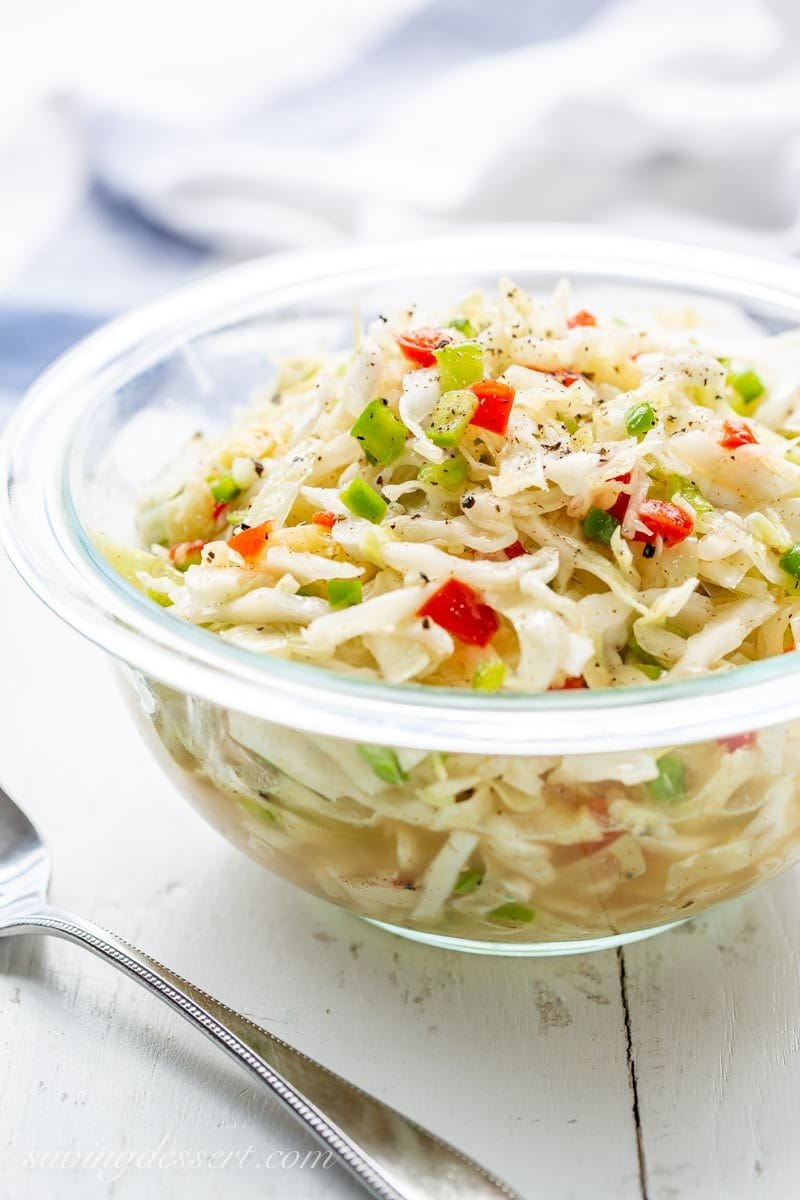 A bowl of mayonnaise free Super Cole Slaw with green bell peppers and pimentos