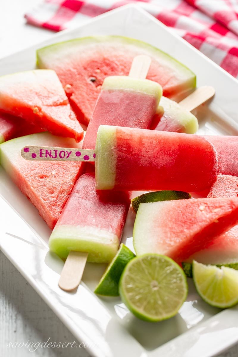 Sliced watermelon and watermelon popsicles with lime