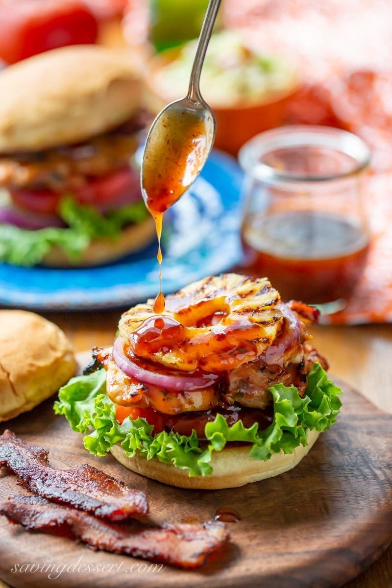 A drizzle of sauce on our Grilled Hawaiian Chicken Sandwich with pineapple, black pepper bacon with lettuce, tomato and onion