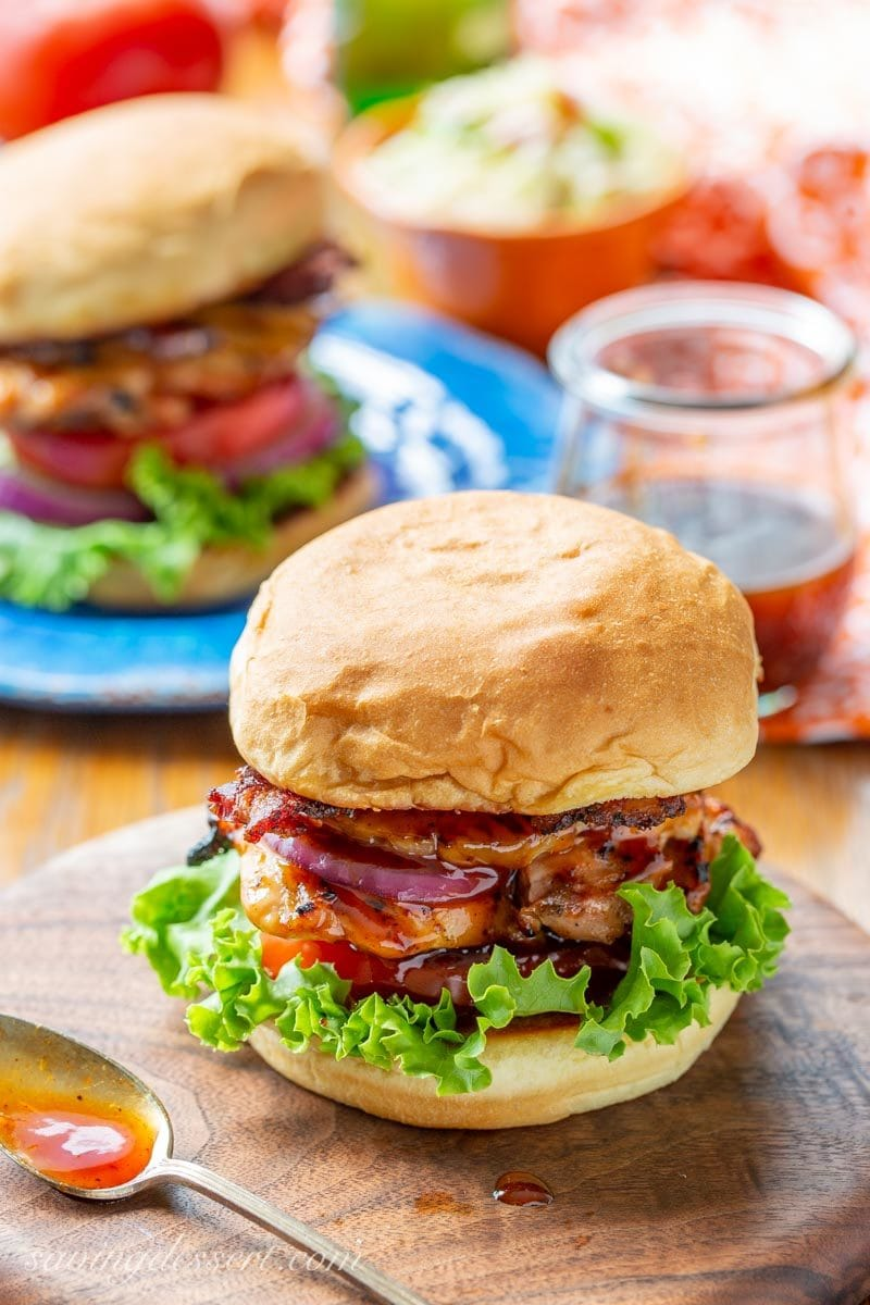 Grilled Hawaiian Chicken Sandwich with pineapple, black pepper bacon and a sticky sweet pineapple sauce, with lettuce, tomato and onion