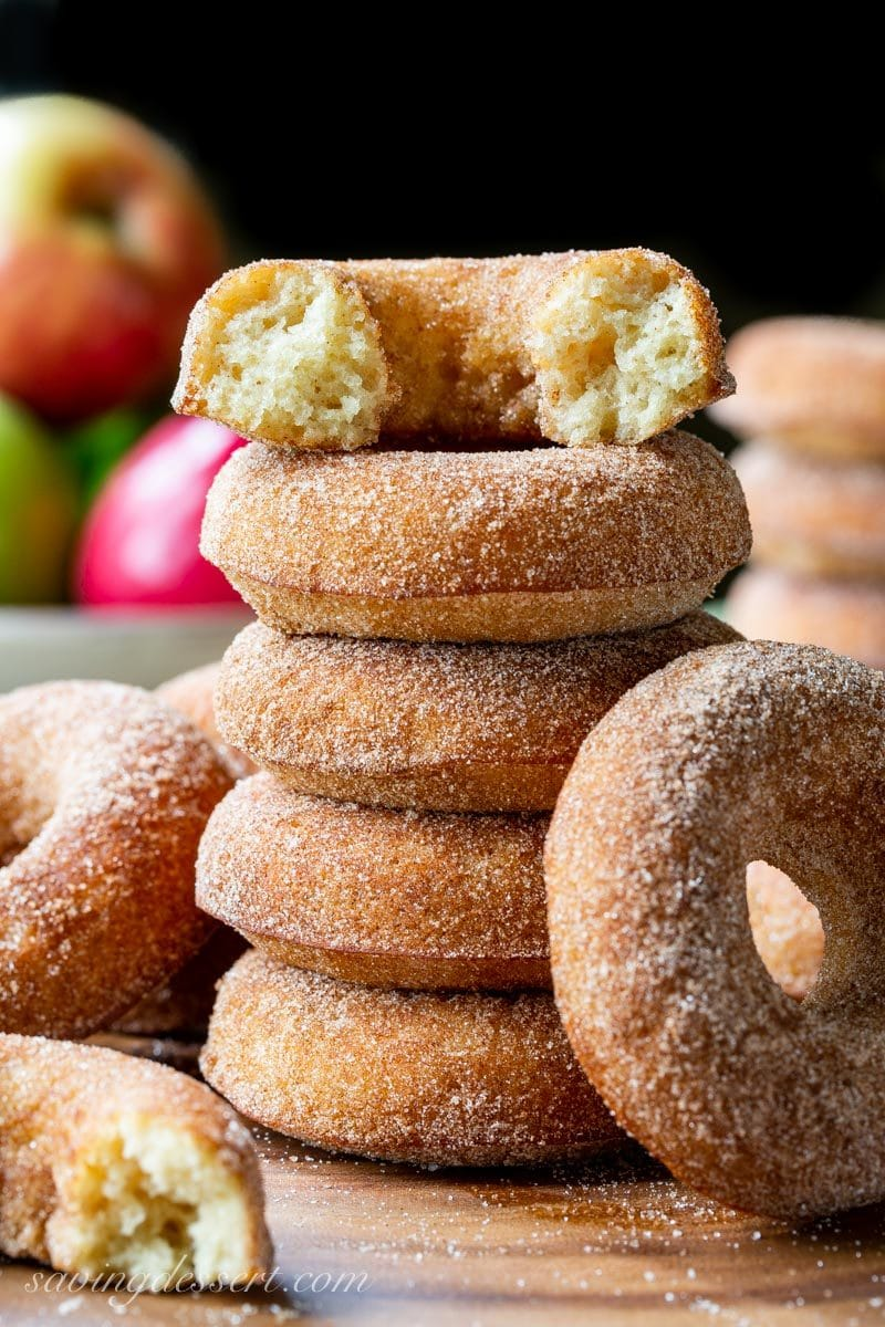 A stack of cinnamon sugar coated baked apple cider doughnuts