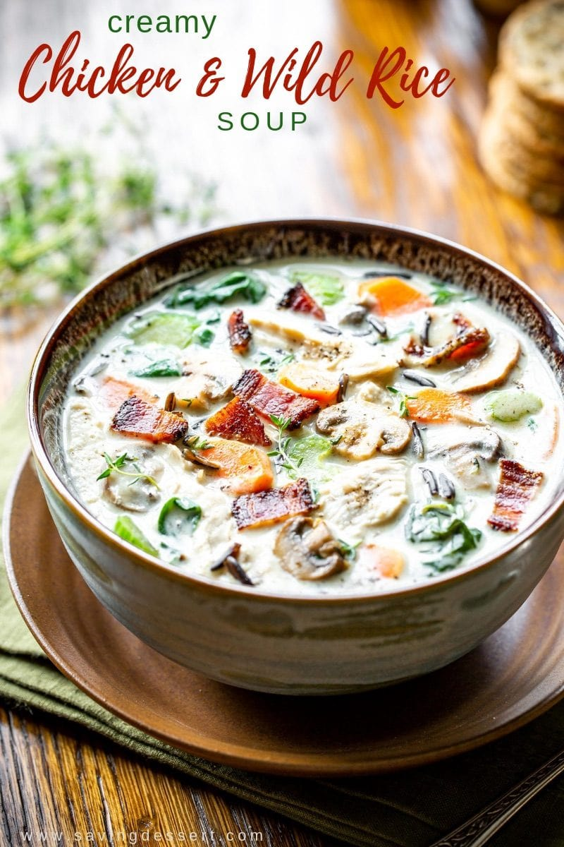 Creamy Chicken and Wild Rice Soup  - this delicious soup checks all the boxes for a perfect bowl of fall comfort food. It's creamy and hearty with a nutty bite from the wild rice and a wonderful flavorful broth. #savingroomfordessert #wildrice #wildricesoup #chickenwildricesoup #soup #chickensoup #comfortfood