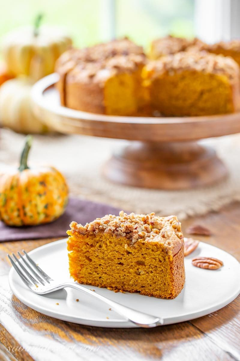 A slice of Pumpkin Breakfast Cake topped with a sweet Pecan Crumble