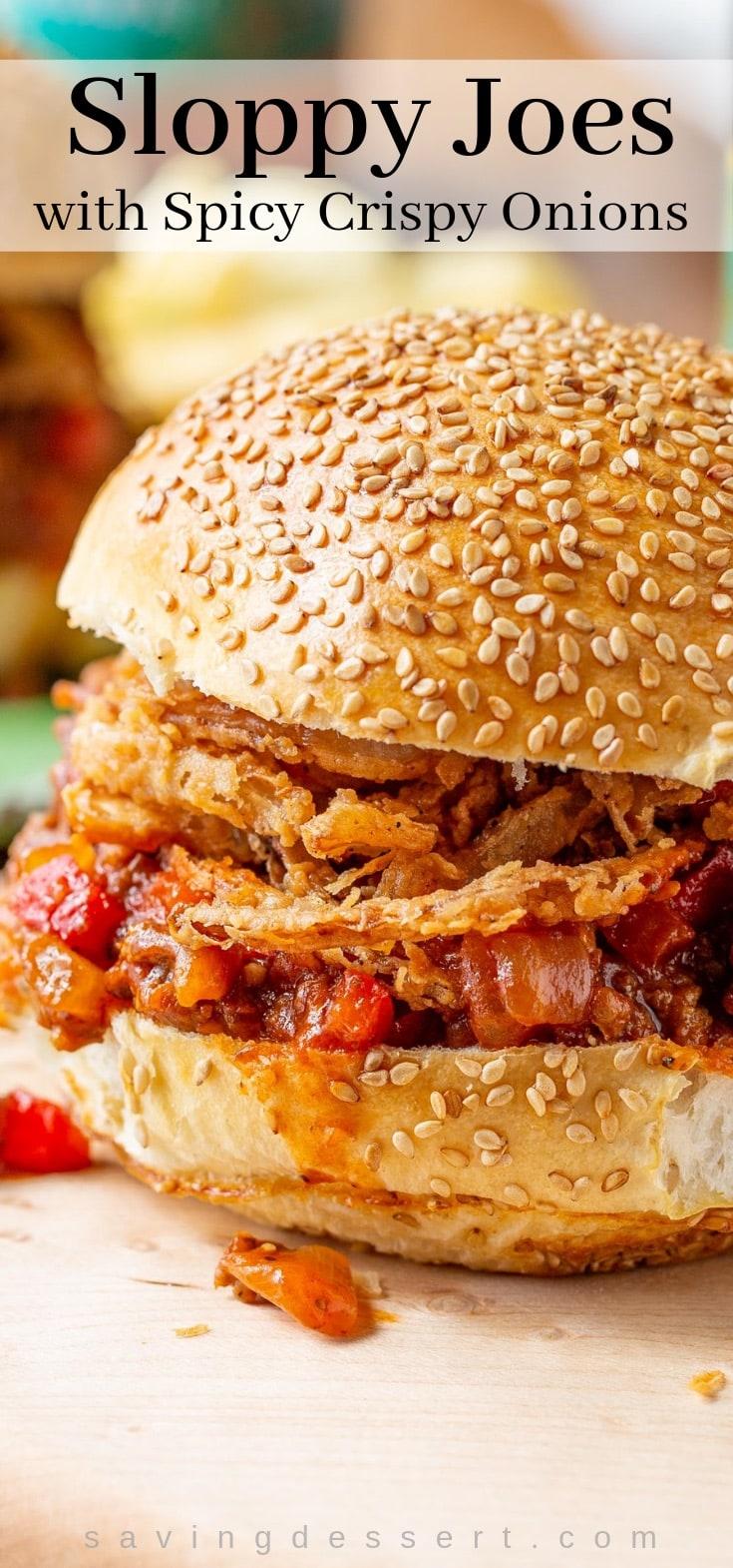 A sloppy joe sandwich with crispy onions and a toasted sesame seed bun
