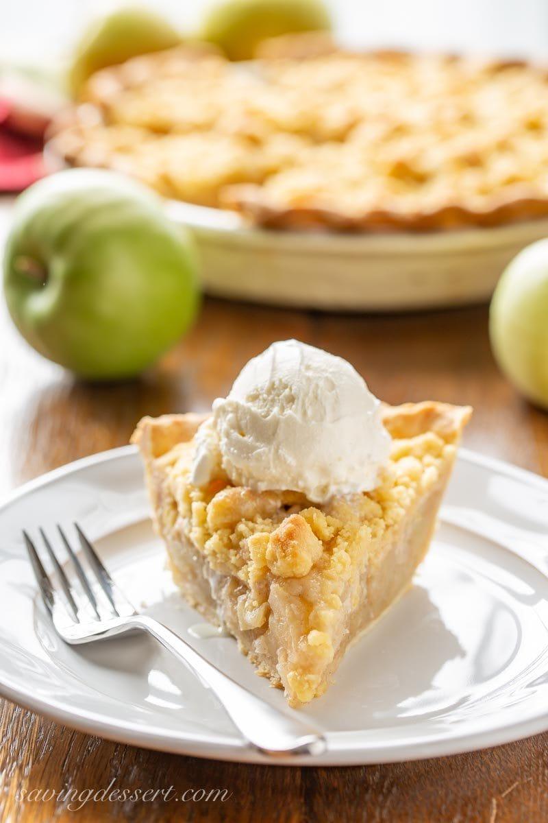 A slice of Dutch Apple Pie with a scoop of vanilla ice cream