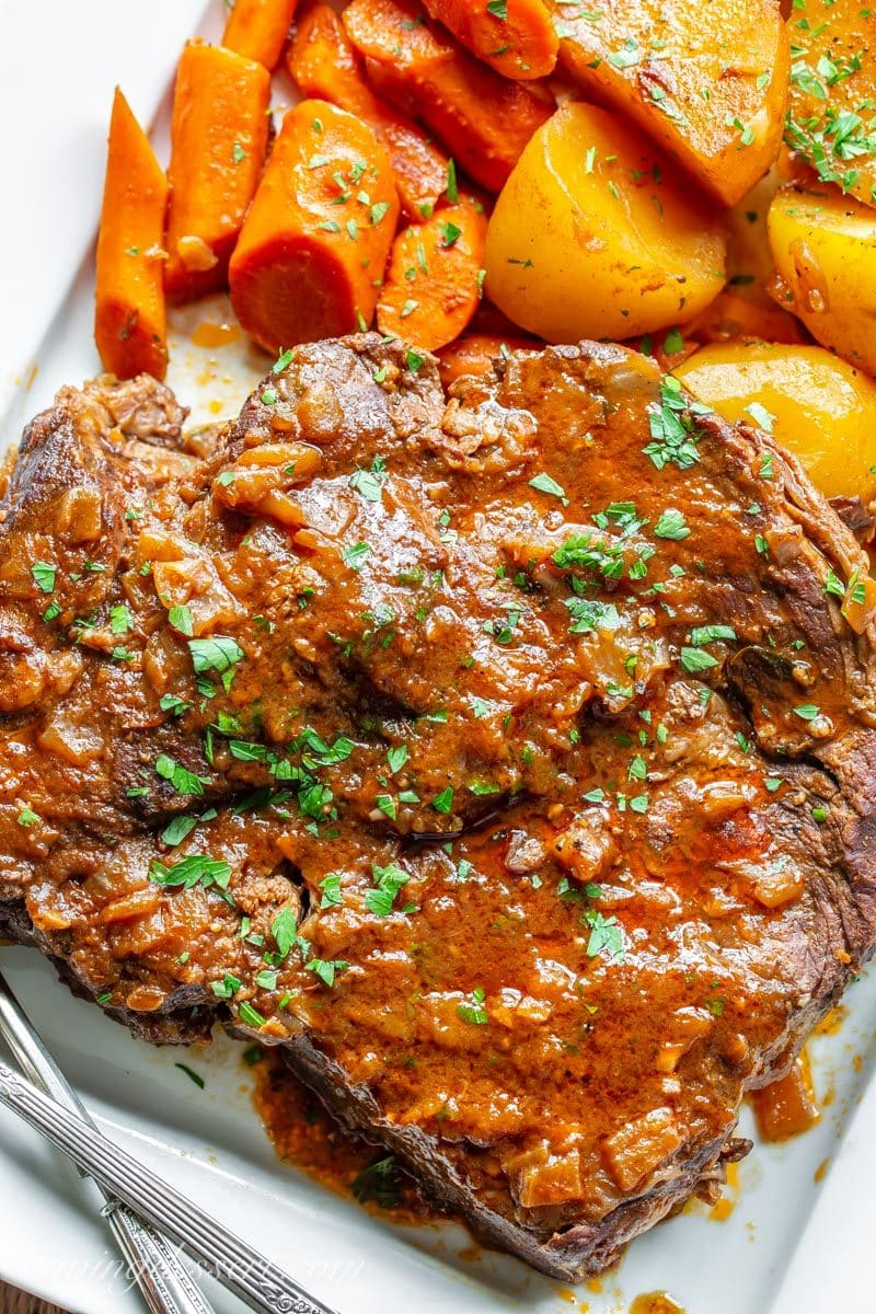 a juicy, tender and flavorful oven-braised pot roast with carrots and potatoes