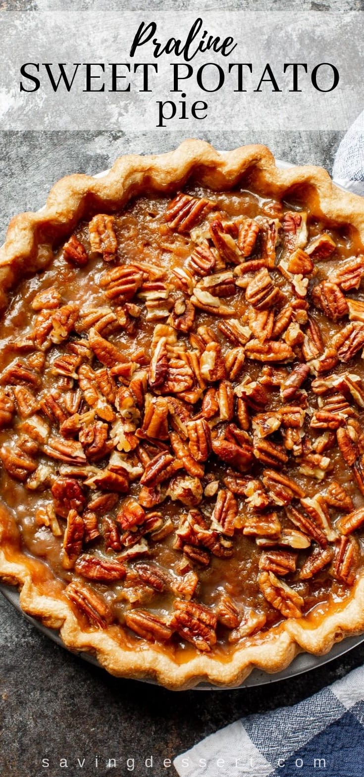 An overhead view of a Praline Sweet Potato Pie covered with pecans