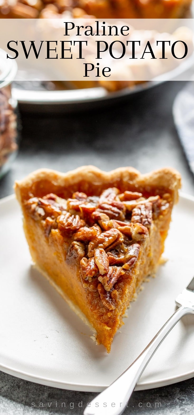 A slice of praline sweet potato pie on a plate covered with pecans
