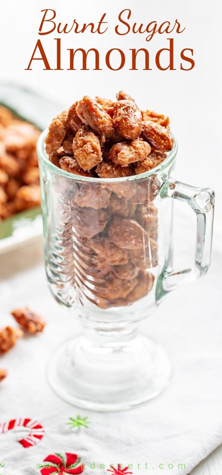 A clear mug of burnt sugar almonds