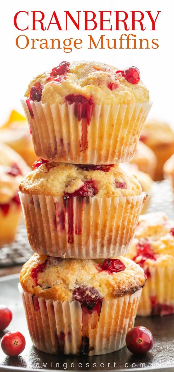 A stack of three cranberry orange muffins
