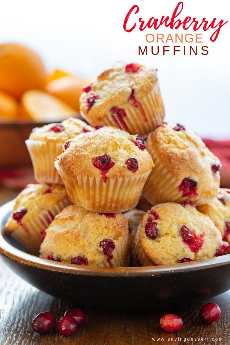 A bowl of cranberry orange muffins with fresh cranberries