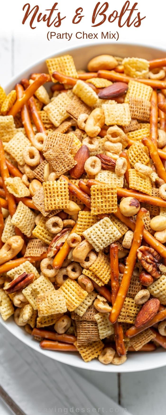 Nuts & Bolts, also known as Party Chex Mix, is one of the easiest, most beloved, delicious, quintessential holiday snacks ever invented! A terrific snack for the holidays, parties and football! #savingroomfordessert #chexmix #chexmixrecipe #nuts&bolts #snackmix #appetizer #holidays #chexrecipe #recipe