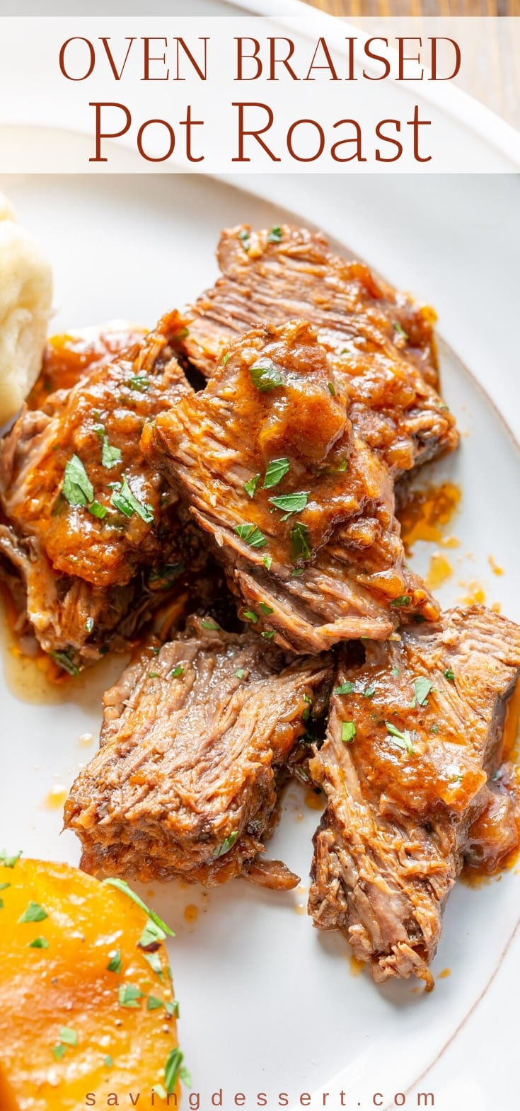 A plate with sliced oven braised roast beef