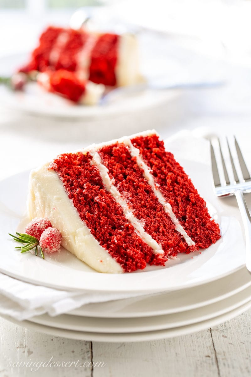 A slice of red velvet cake with cream cheese icing