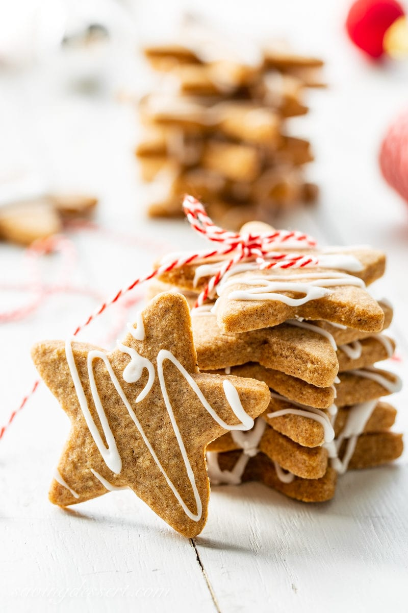 A stack of star shaped Speculaas Cookies with a simple drizzled icing