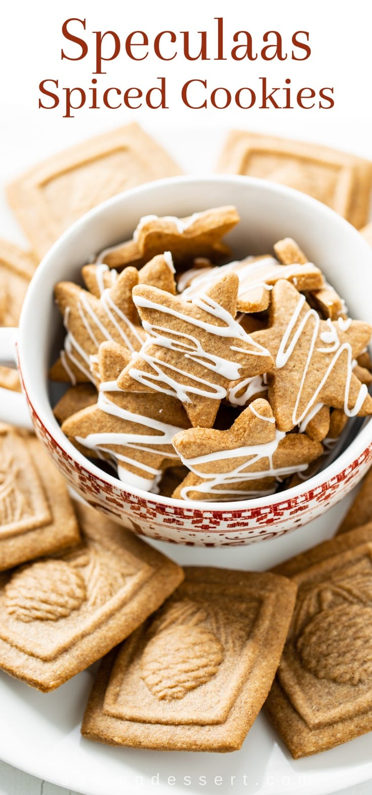 A bowl of spiced star cookies topped with a drizzle of icing