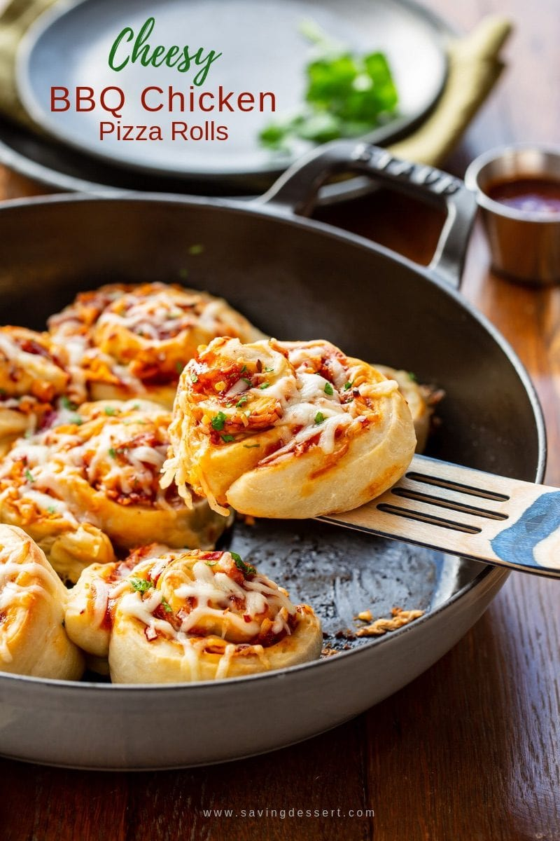 A skillet with Cheesy BBQ Chicken Pizza Rolls garnished with parsley