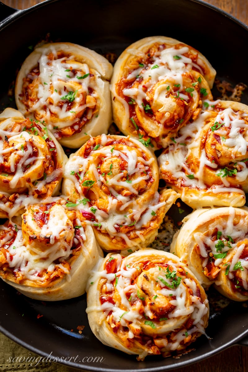 A skillet filled with cheesy pizza rolls