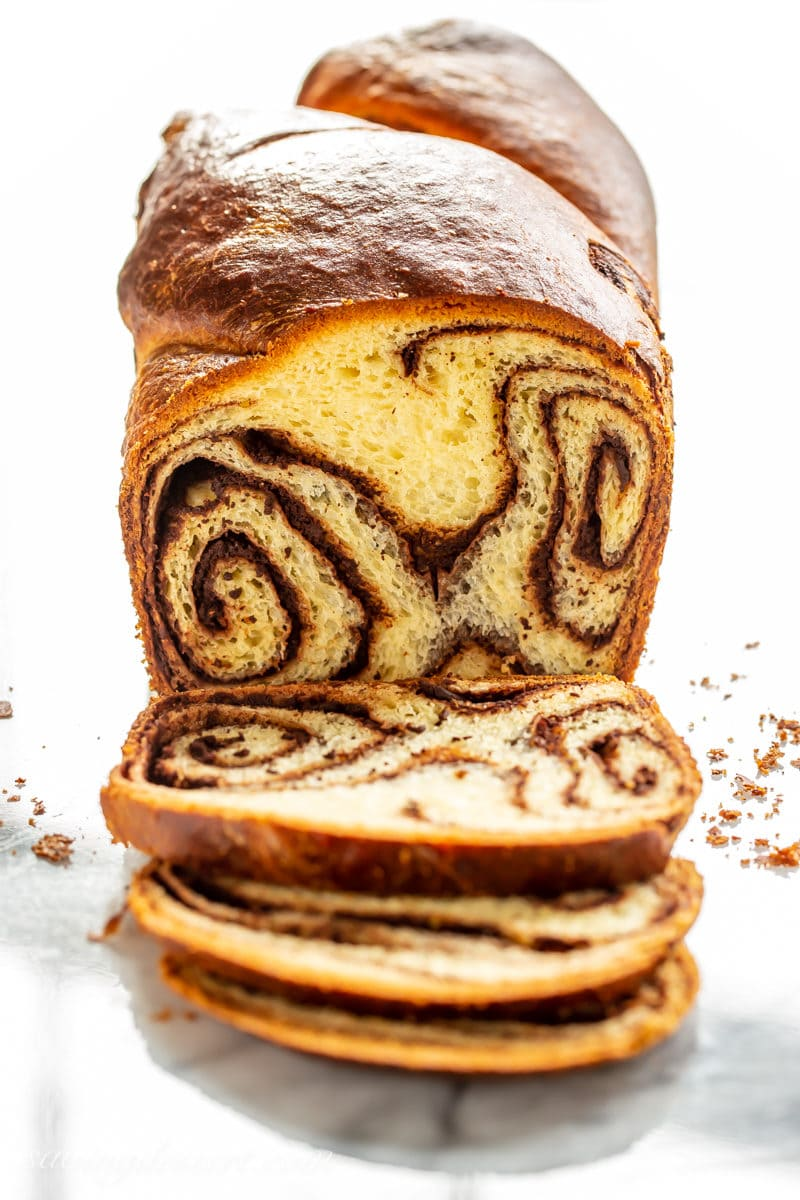 A sliced loaf of chocolate babka