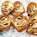 Sliced chocolate Babka on a marble cutting board