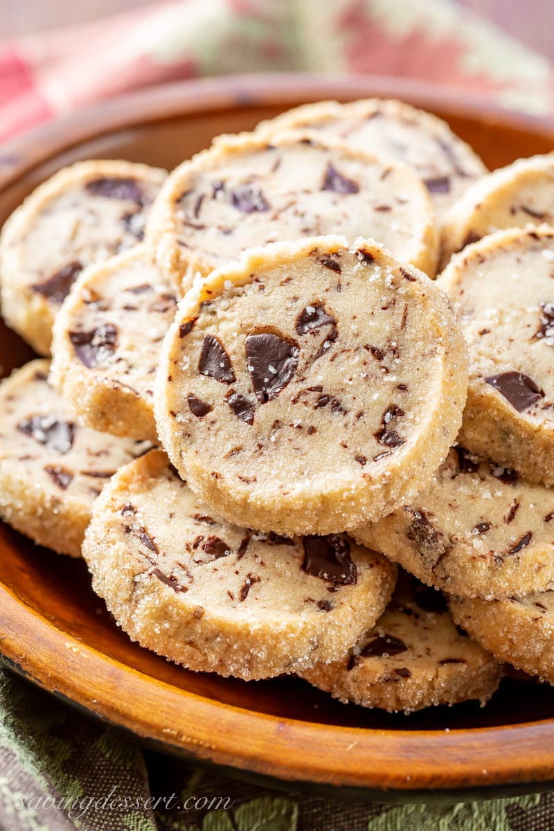 An up close view of a Chocolate Chunk Shortbread Cookie sprinkled with flaky sea salt