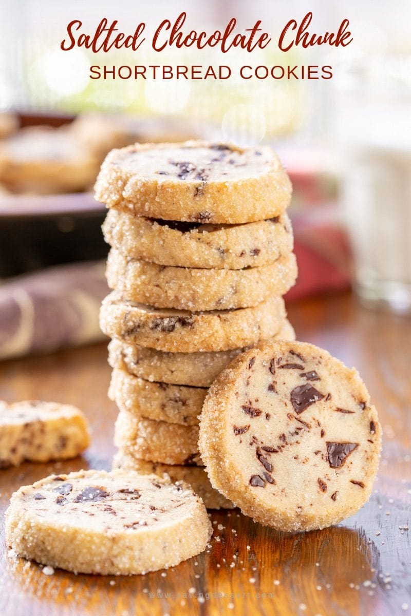 A stack of Salted Chocolate Chunk Shortbread Cookies with a sprinkling of sea salt