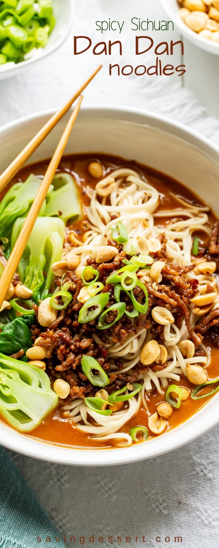 Spicy Dan Dan Noodles Recipe with a rich peanut sauce, blanched fresh vegetables, crispy minced pork, and plenty of slurp-able noodles garnished with scallions and peanuts. #savingroomfordessert #spicyasian #dandannoodles #asiannoodlerecipe #asiannoodles #peanutsauce #asian #sichuan
