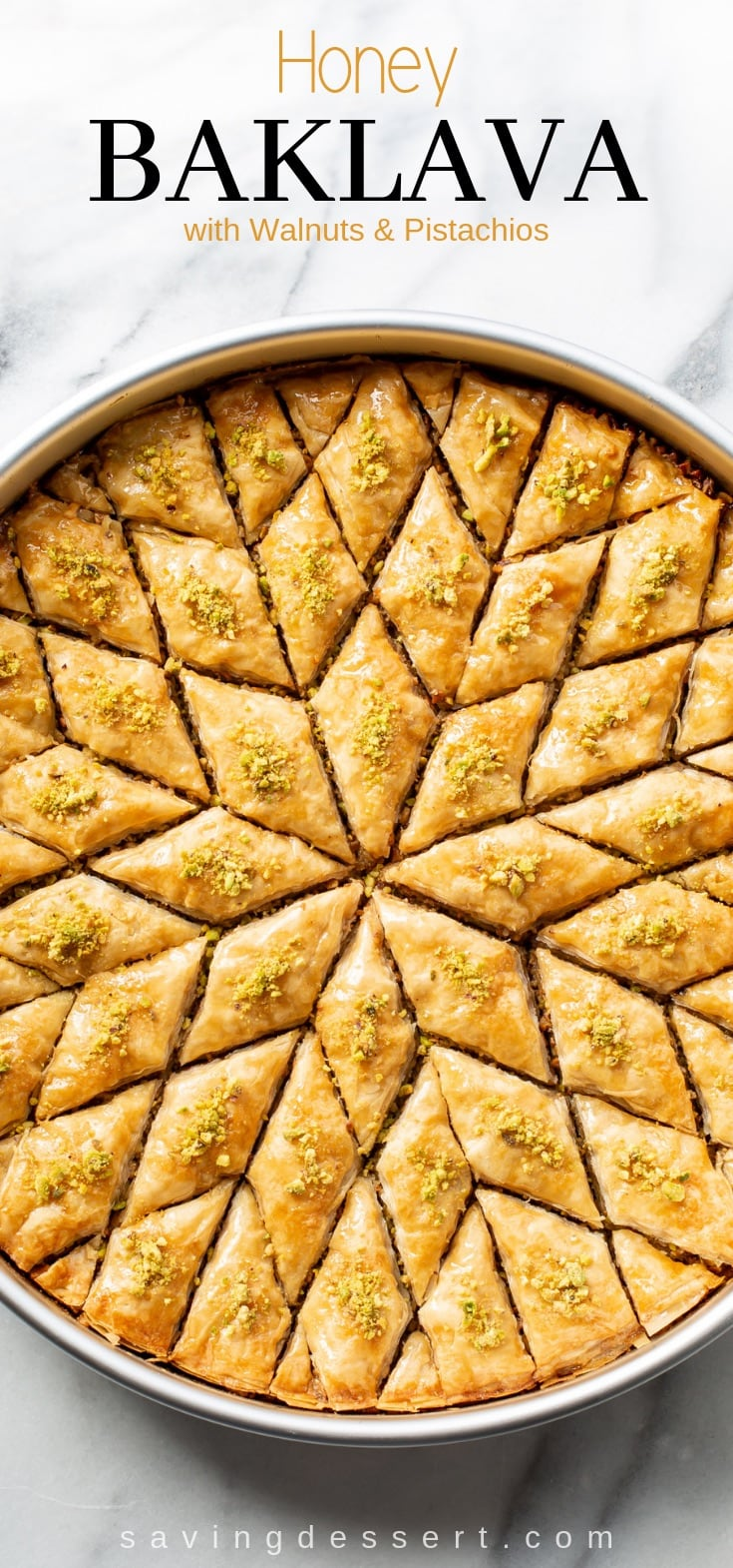 Honey Baklava Recipe with Walnuts and Pistachios - layers and layers of flaky phyllo slathered with melted butter, honey and loads of nuts - who can resist a slice of this delicious Honey Baklava Recipe #baklava #honeybaklava #pistachiobaklava #walnutbaklava #Greekbaklava #honey #dessert