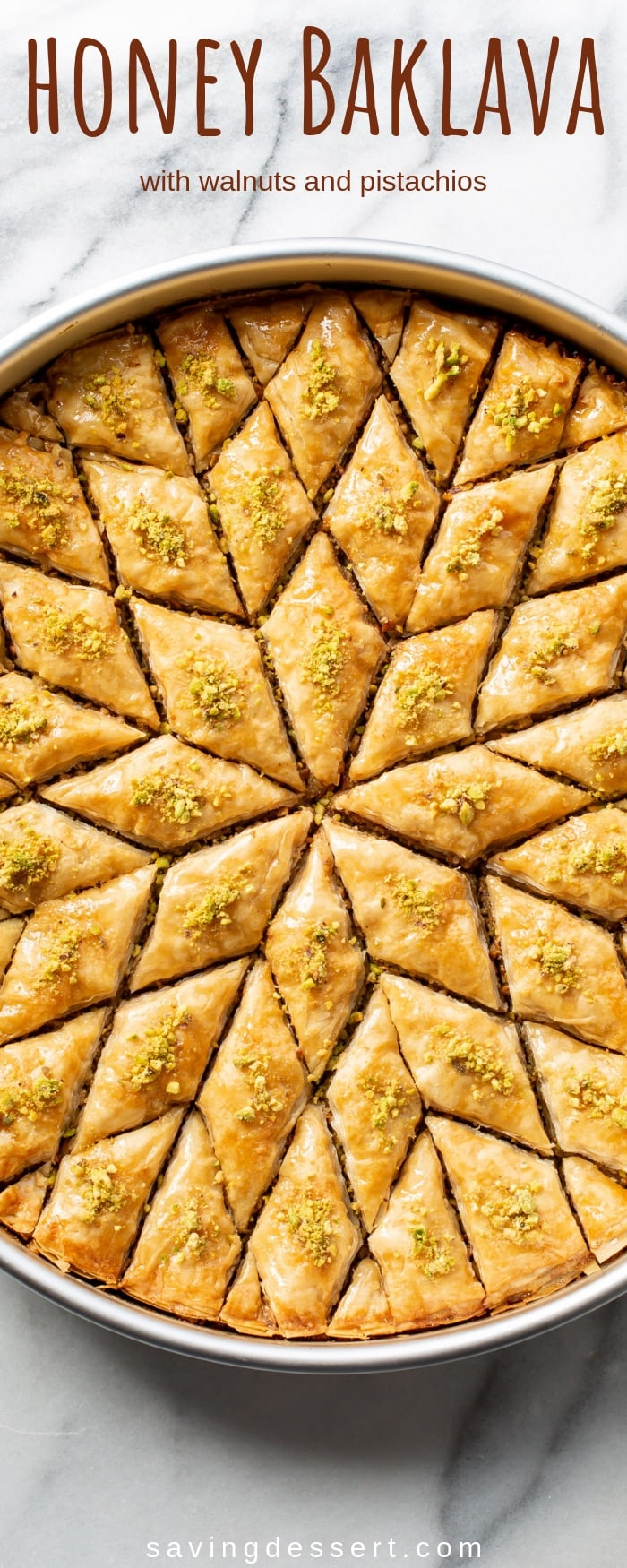 Honey Baklava Recipe with Walnuts and Pistachios - layers and layers of flaky phyllo slathered with melted butter, honey and loads of nuts - who can resist a slice of this delicious Honey Baklava Recipe?! #savingroomfordessert #baklava #honeybaklava #pistachiobaklava #walnutbaklava #Greekbaklava #honey #dessert