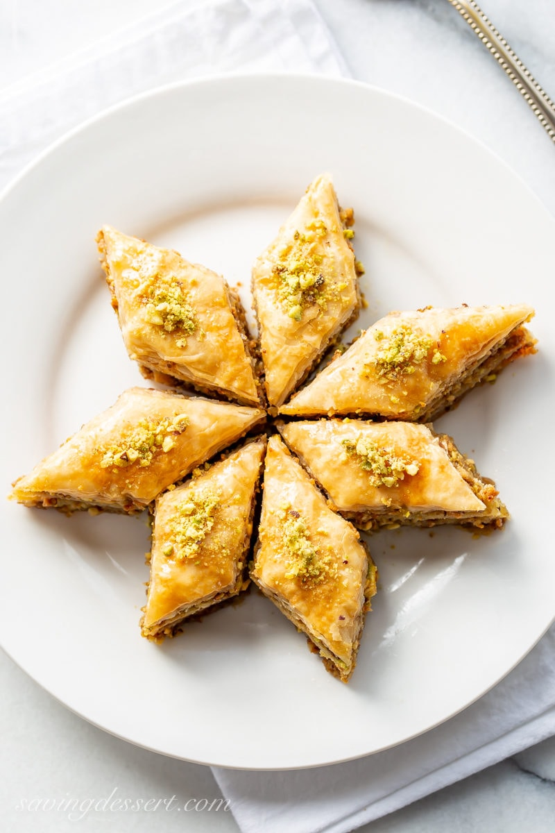 A few pieces of honey baklava cut into a diamond pattern and arrange on a plate into a flower.