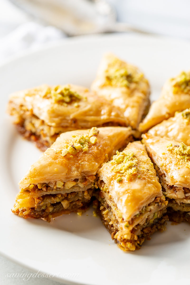A few slices of honey baklava with pistachios with flaky, buttery layers