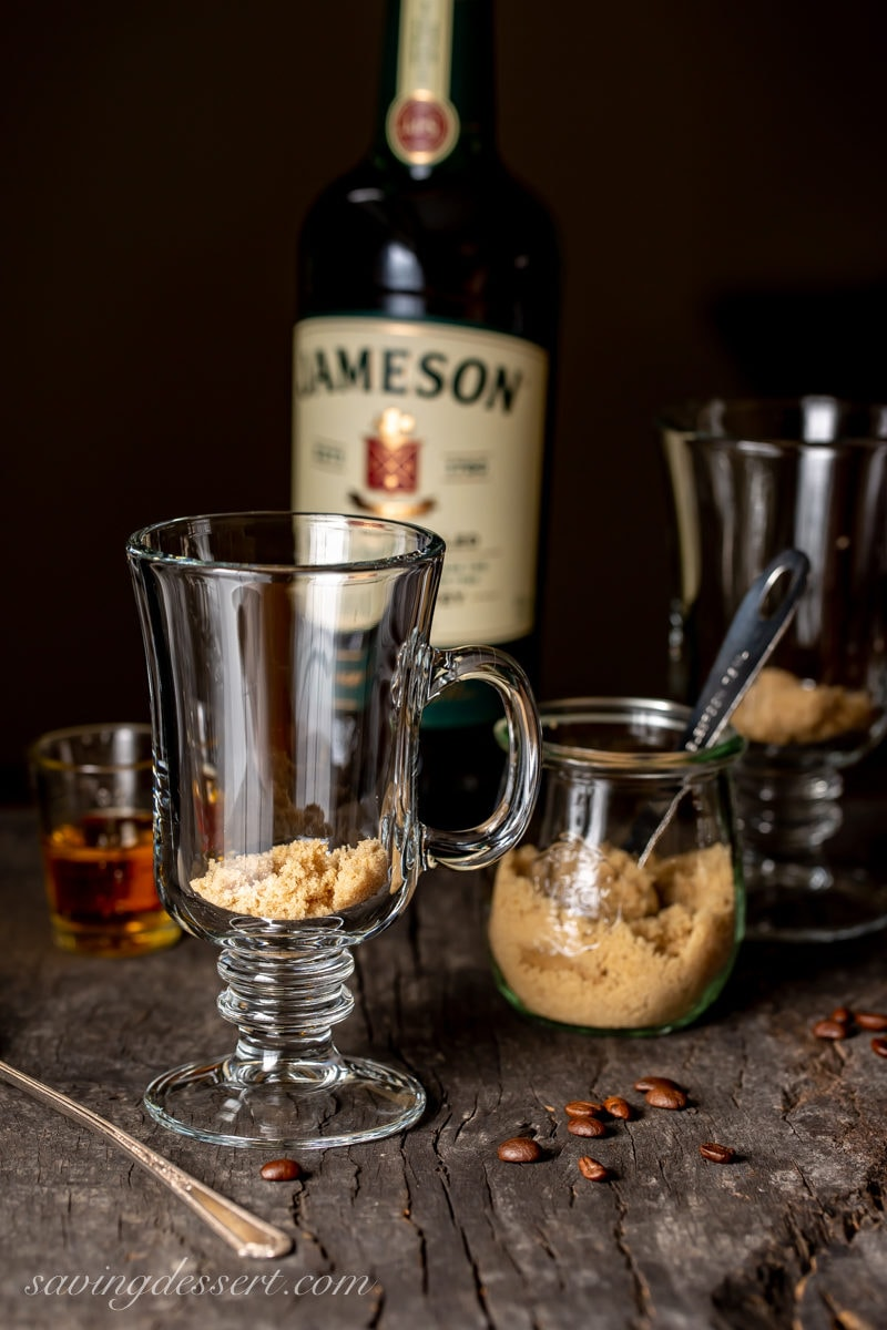 Mugs with brown sugar as the first step in making Irish Coffee
