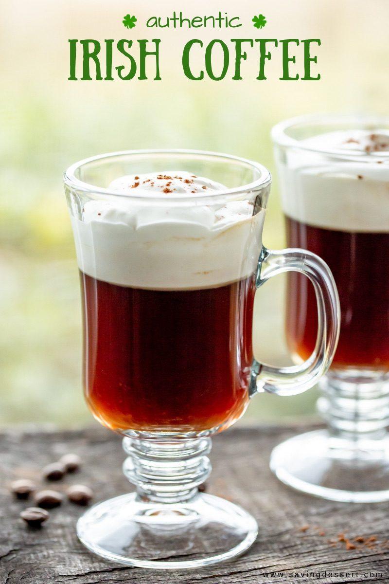 Mugs of hot Irish Coffee with soft whipped cream on top