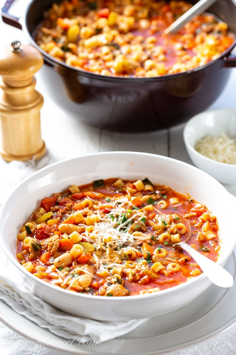A bowl and pot of Pasta e Fagioli Soup with beans, tomatoes and ditilini pasta