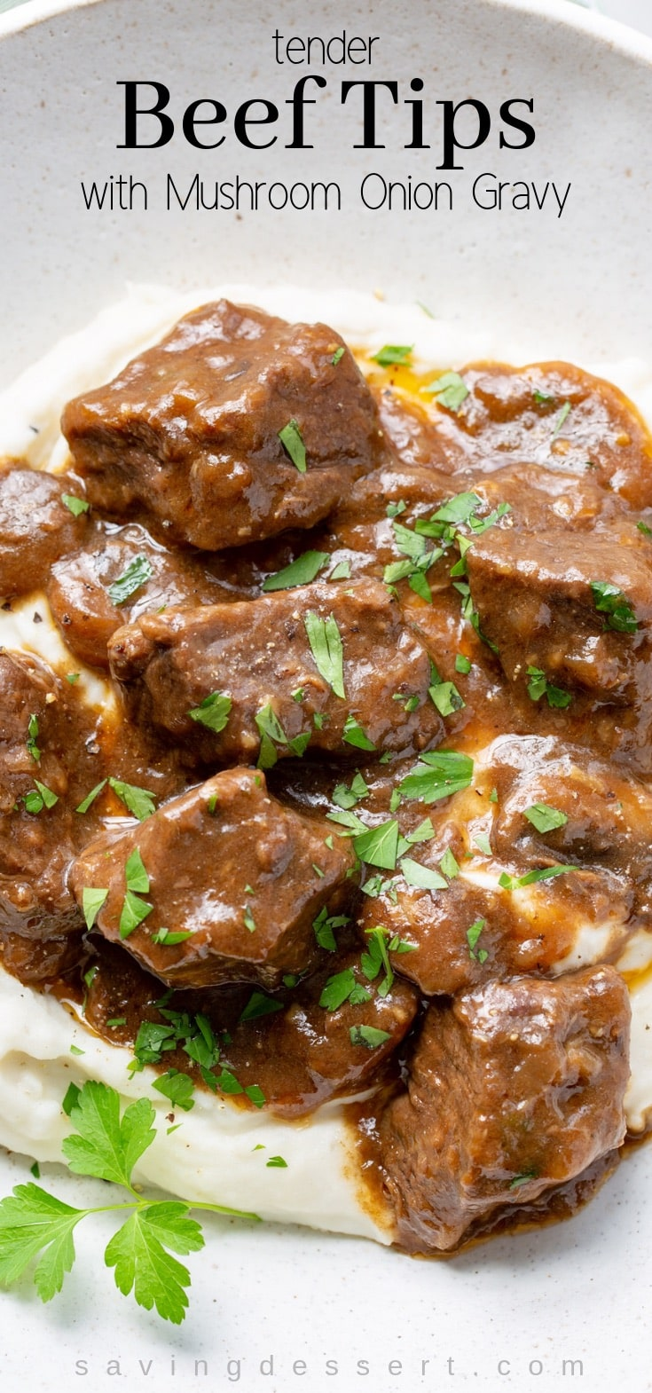 Beef Tips and Gravy with mushrooms and onions is a deliciously tender dish perfect served over fluffy mashed potatoes, buttery noodles or hot cooked rice. #beeftips #beeftipsandgravy #beeftipsandnoodles #beef #stewmeat #chuckroast #mushroomoniongravy #dinner #comfortfood #companyrecipe
