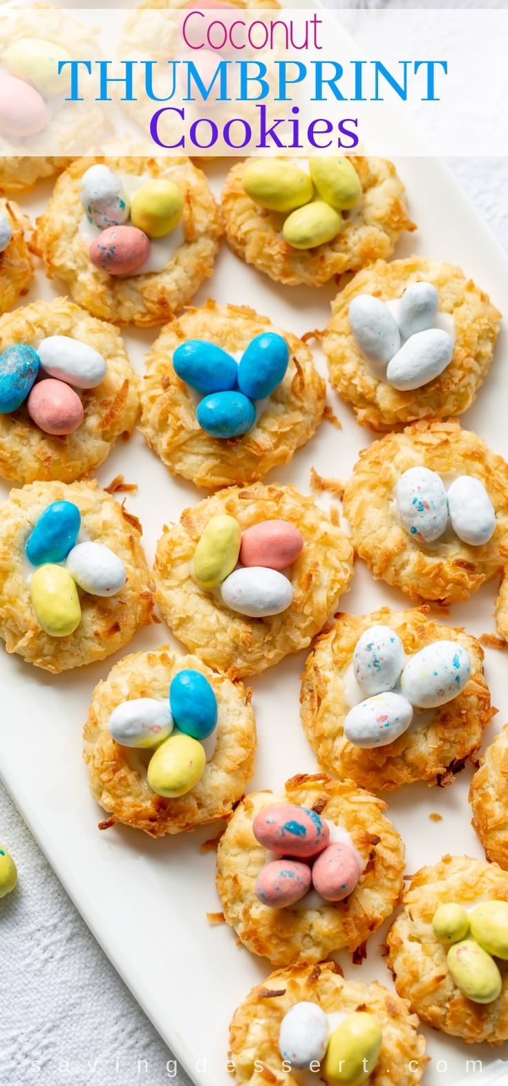 Coconut Thumbprint Cookies decorated with speckled candy eggs. #cookie #Easter #springtime #coconut #coconutcookie #Easterdessert #thumbprint #coconutthumbprintcookie #dessert #baking