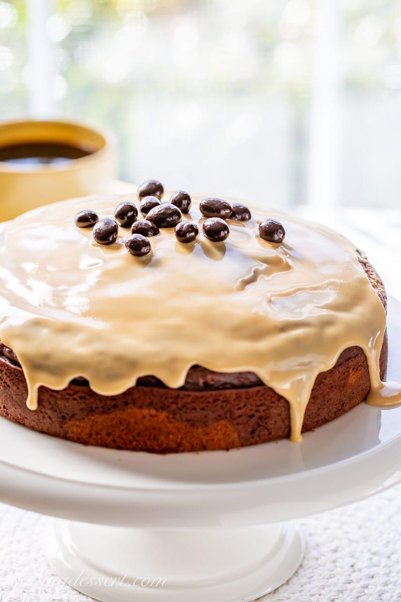 An Irish Cream Breakfast Cake with a spirited coffee flavored glaze garnished with espresso beans