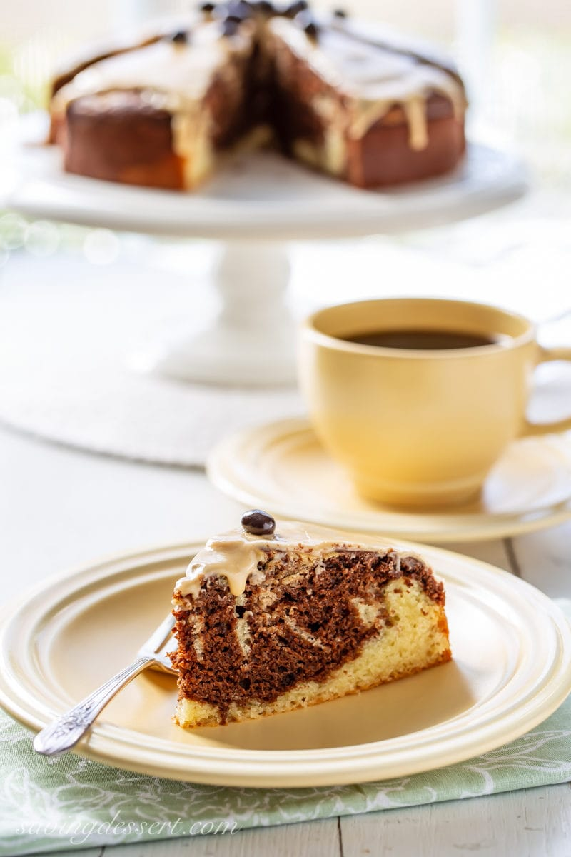 A slice of Irish Cream Breakfast Cake served with hot coffee