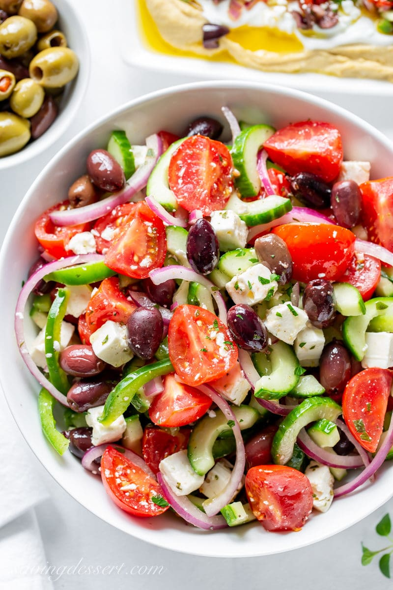 A fresh, crisp Greek Salad with cucumbers, tomatoes, onions, olives and feta cheese