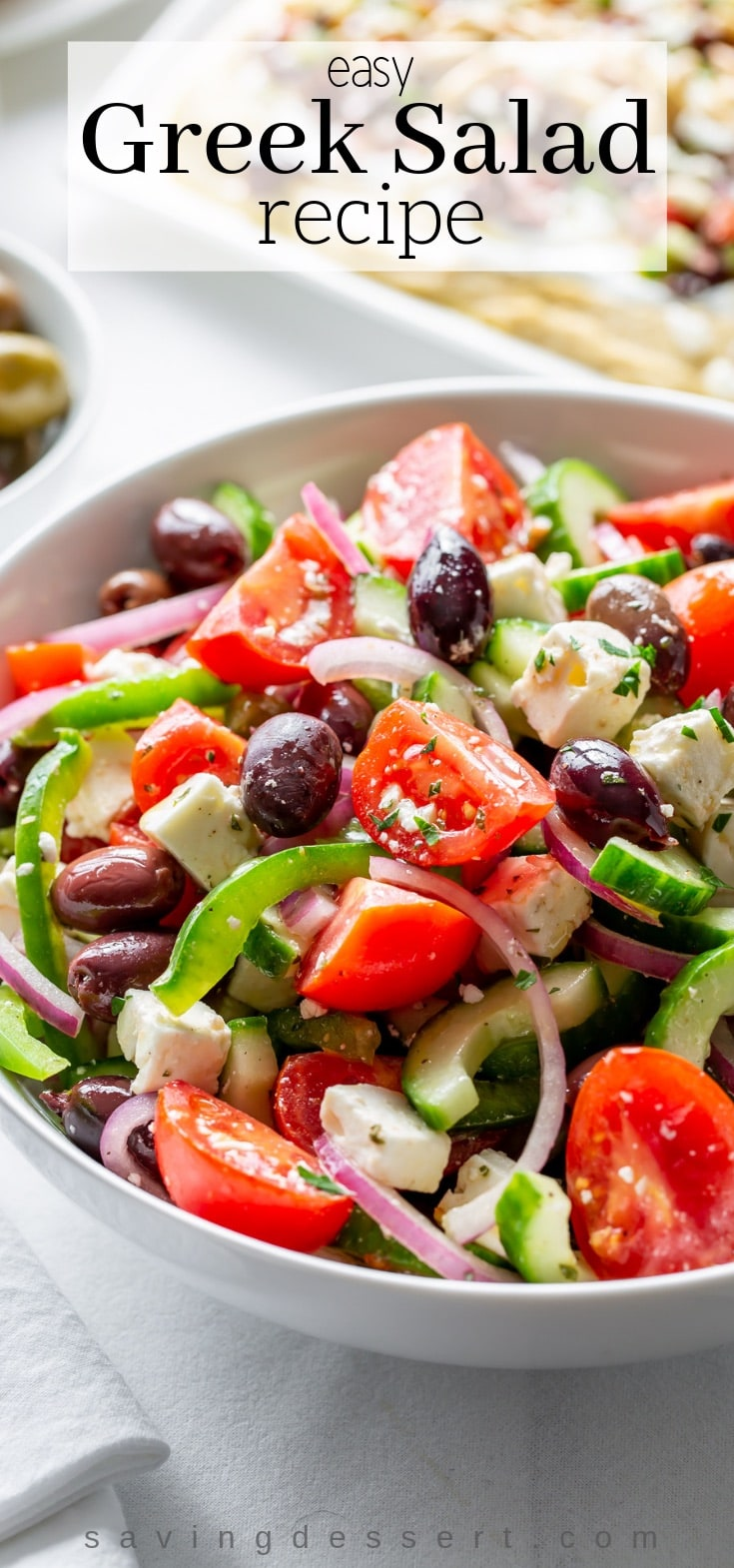 Enjoy this easy Greek Salad Recipe made with crisp, fresh vegetables, feta cheese and olives, simply dressed with herbs, oil and vinegar. #Greeksalad #Greek #easysalad #salad #Greeksaladrecipe #saladrecipe